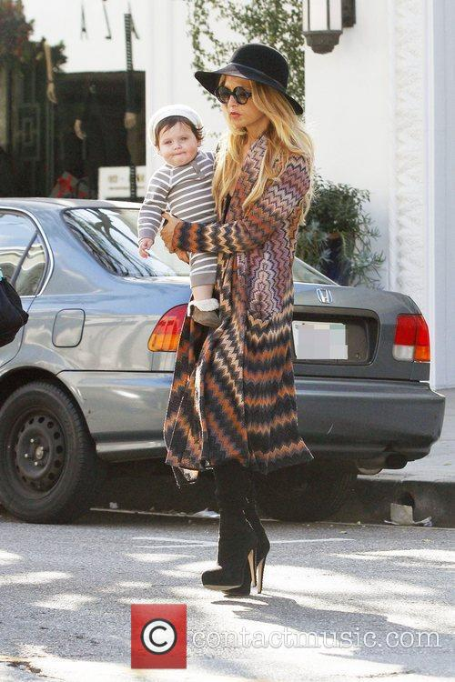 Rachel Zoe carries her son Skyler while out...