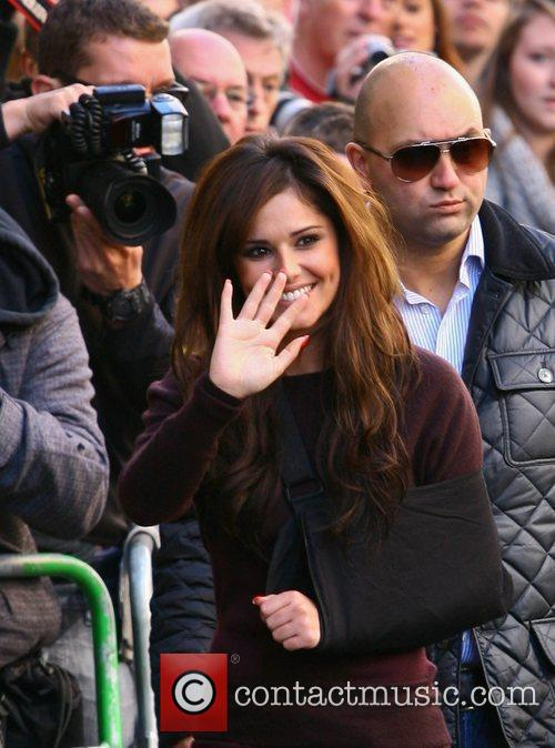 Cheryl Cole, with her arm in a sling...