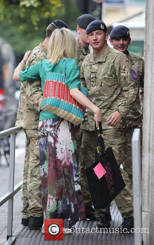 Fearne Cotton speaking to some soldiers at the...