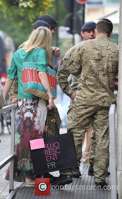 Fearne Cotton speaks to some soldiers outside the...