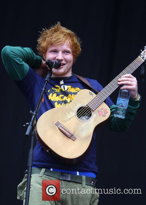 ed sheeran performing live on stage at 3959799