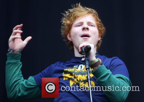 ed sheeran performing live on stage at 3959809
