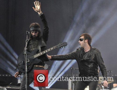 Sergio Pizzorno and Tom Meighan of Kasabian performing...