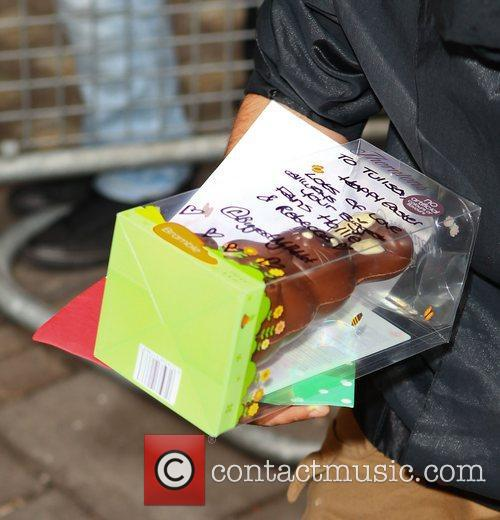 An easter egg presented to Tulisa Contostavlos as...