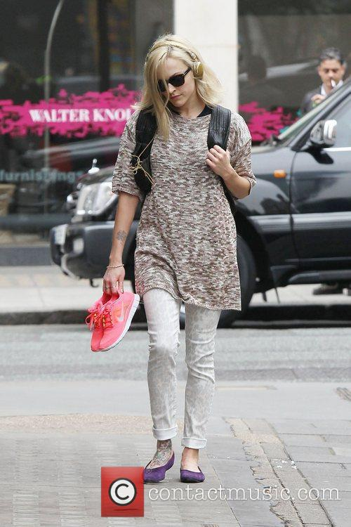 Arriving at the BBC Radio One studios carrying...