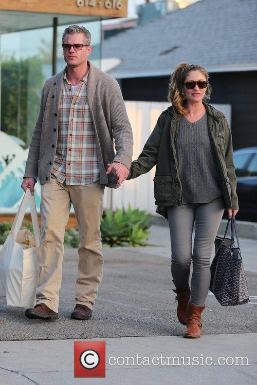 Hold hands while exiting Andy LeCompte salon in...
