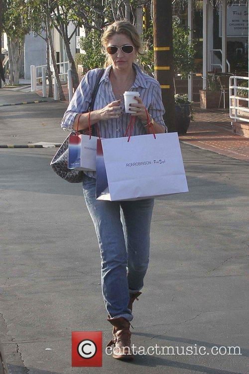 rebecca gayheart seen holding her coffee and 5957356