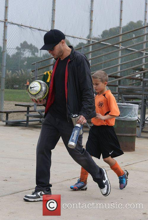 Ryan Phillippe watches her son Deacon's soccer game...