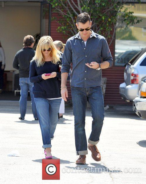 Reese Witherspoon and husband, Jim Toth leaving church...