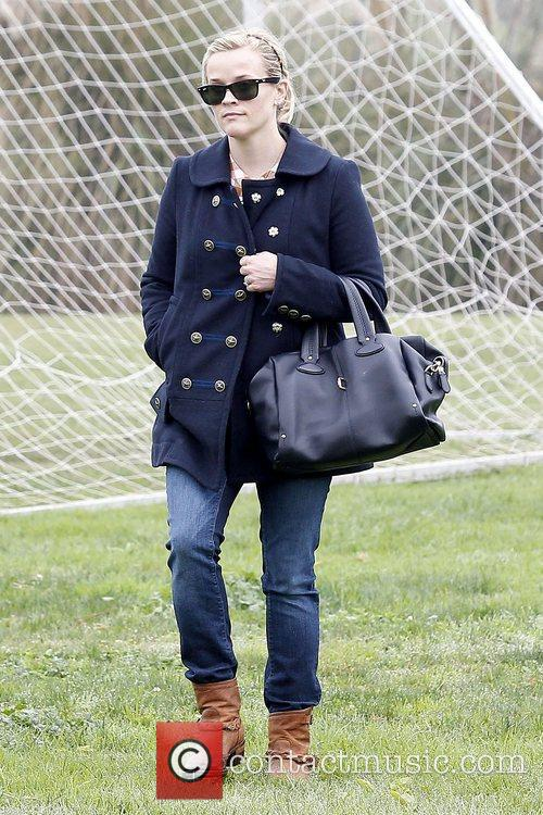 Reese Witherspoon watches her son Deacon's soccer game...