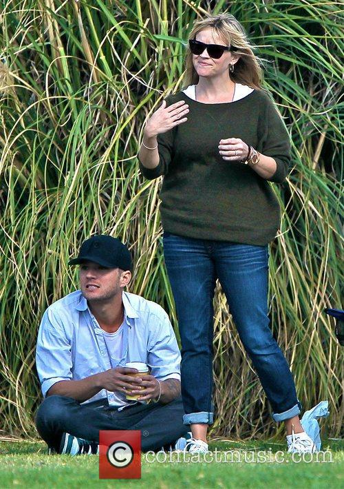 Ryan Phillippe and Reese Witherspoon watch their son...