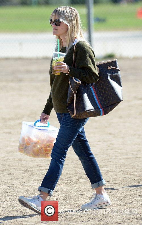 reese witherspoon watches her sons soccer game 4169421