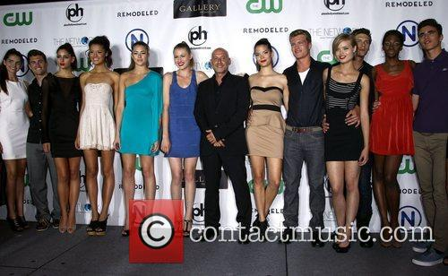 The cast from CW's Hit Show Remodeled celebrate...