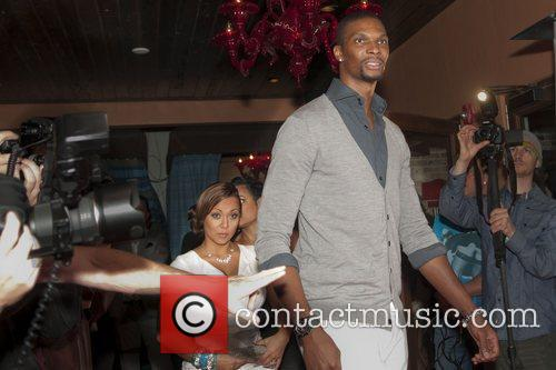 NBA's Miami Heat all-star Chris Bosch and his...