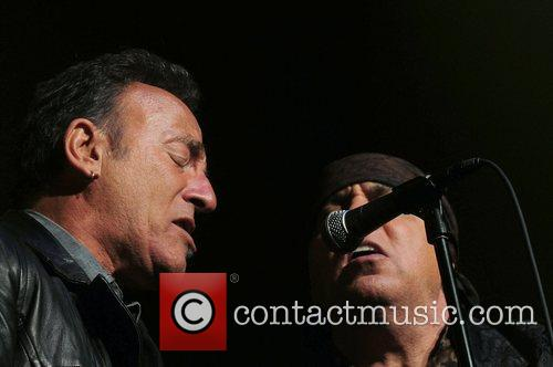 Bruce Sprinsteen and inductee Steven Van Zandt Right...
