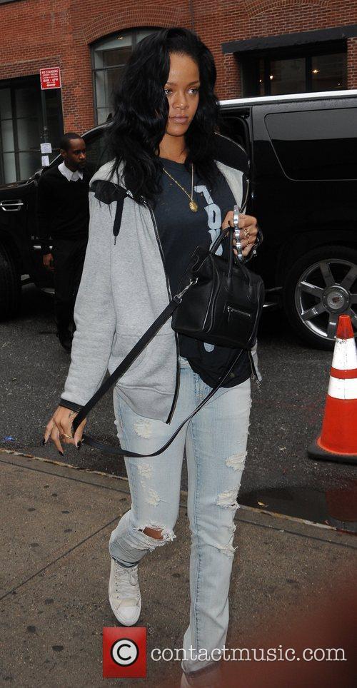 Rihanna seen holding an iPhone case in a...