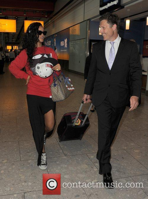 Arrives at Heathrow Airport. She was in town...