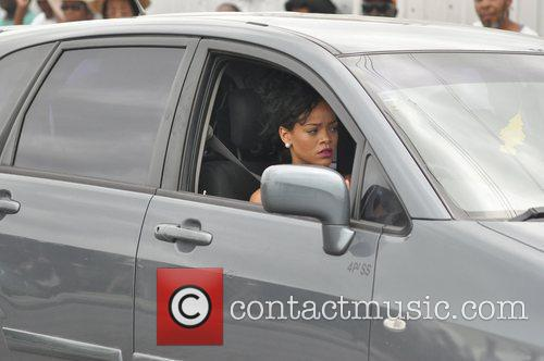 Rihanna attends the funeral of her grandmother Clara...