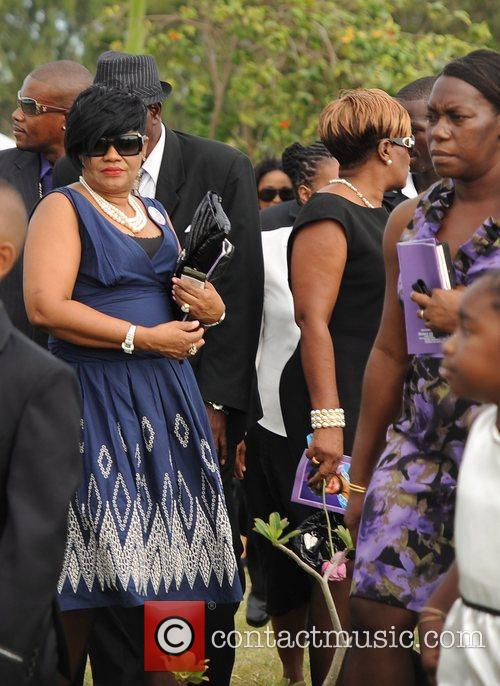 Rihanna  and family attend the funeral for...