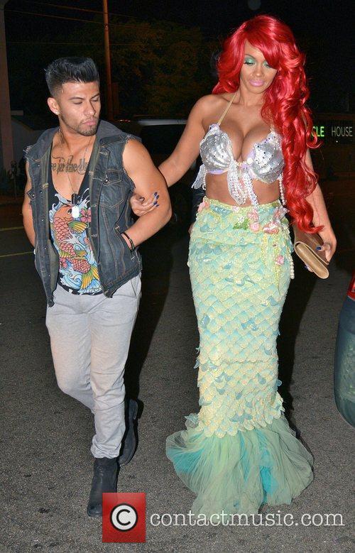 Arrives at Rihanna's Halloween party at Greystones Manor...