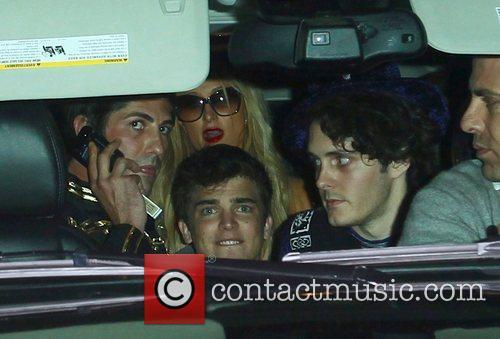Paris Hilton and a carload of friends arrive...