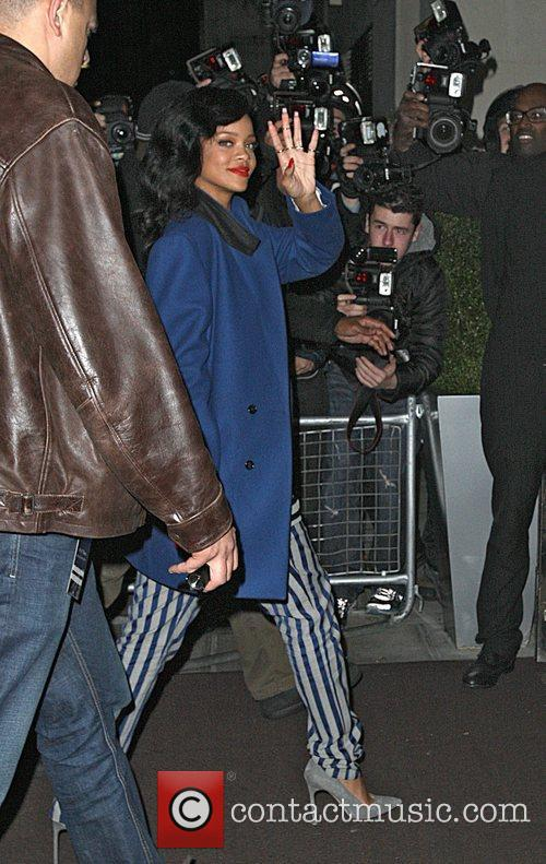 Rihanna returning to her hotel after playing at...