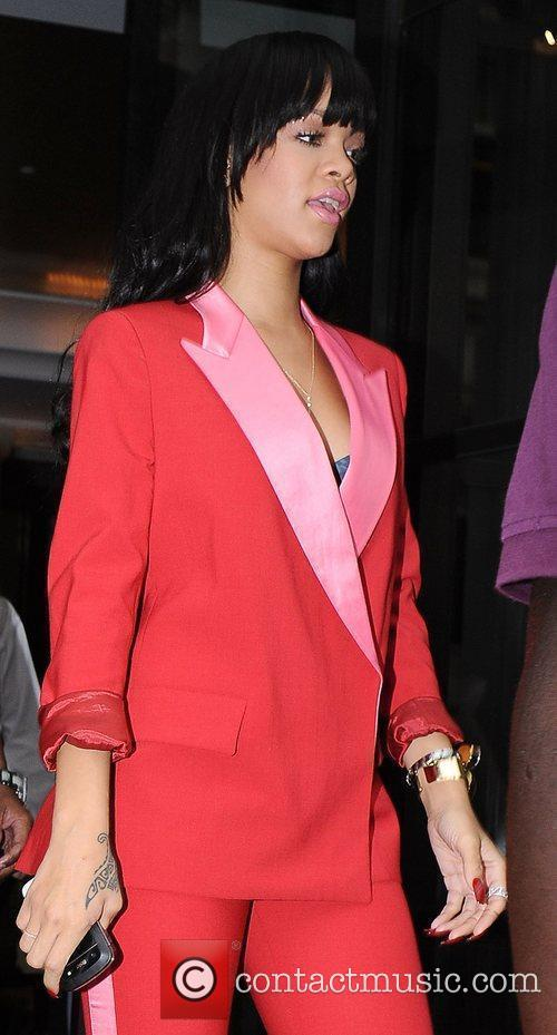rihanna leaves her hotel in red suit 3966937