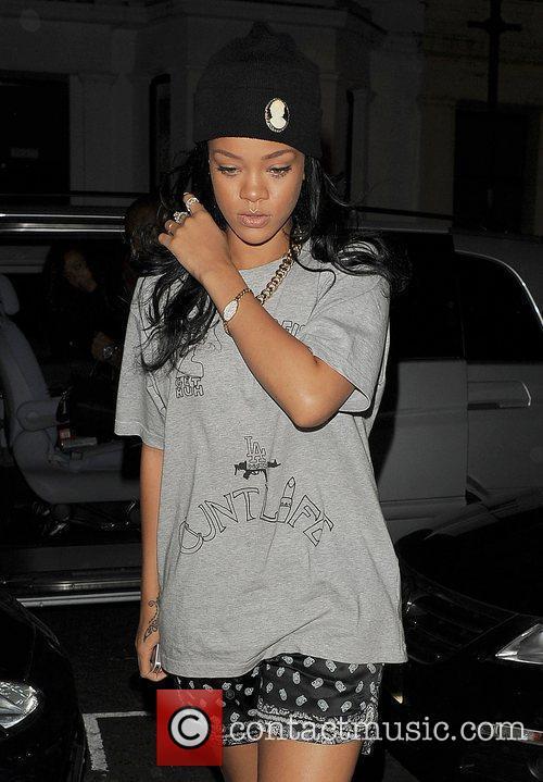 Rihanna arriving at a recording studio late at...