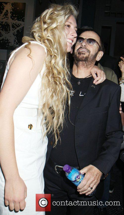ringo starr poses with a fan as 3963482