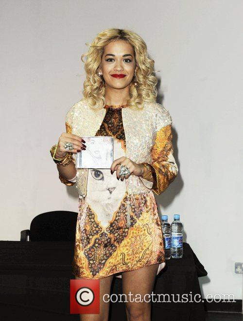 Signs copies of her debut album 'Ora' at...