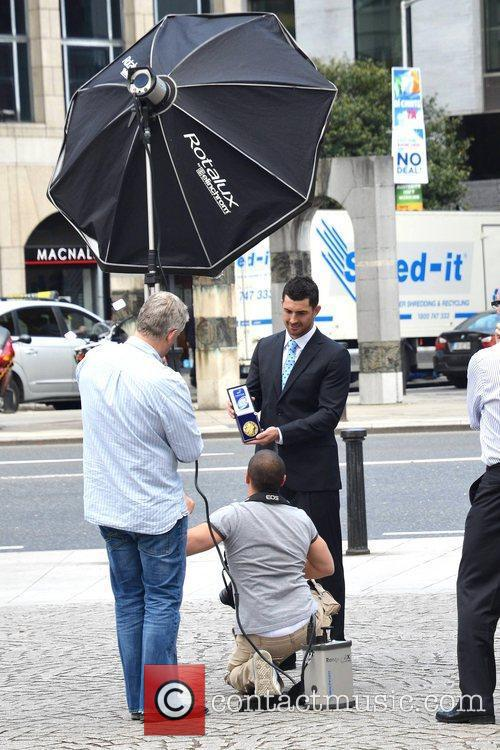 Leinster Rugby Champion Rob Kearney is seen accepting...