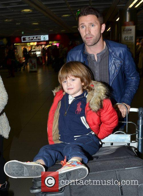 Robbie Keane arriving at Dublin Airport with his...