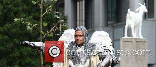 Dresses as a Knight whilst filming his new...