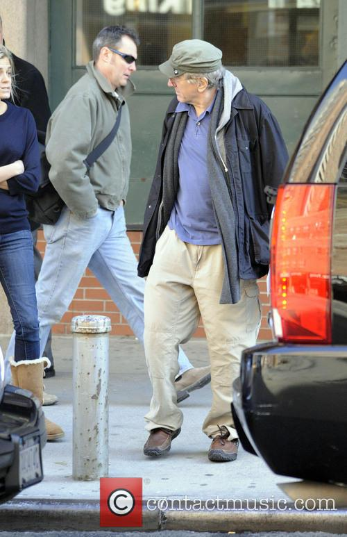A casually dressed Robert De Niro says goodbye...