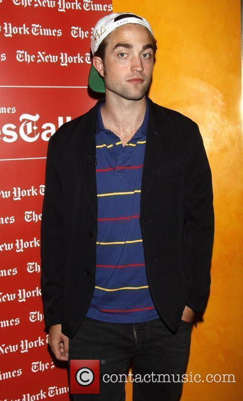 Robert Pattinson  is photographed with his zipper...