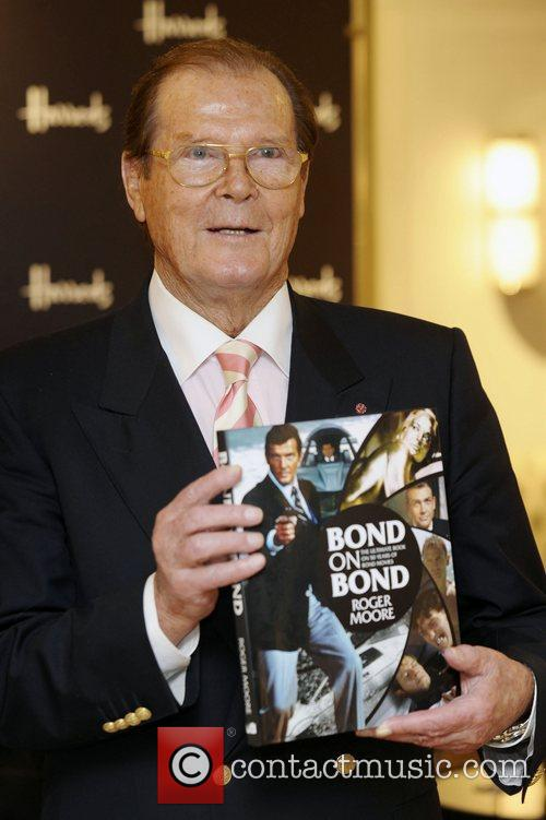 Signing copies of his book entitled 'Bond on...