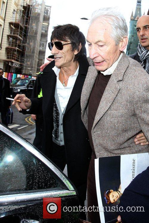Ronnie Wood and Charlie Watts hug before going...
