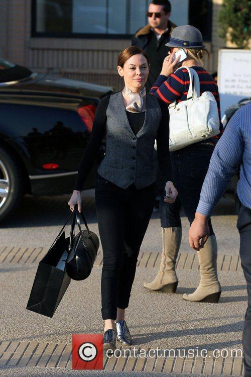 Rose McGowan leaving Barneys New York store in...