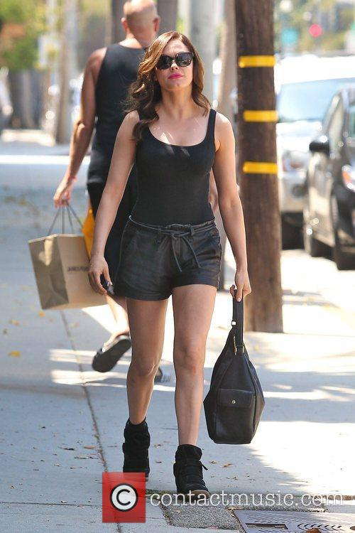 Rose McGowan wearing black leather shorts leaves a...