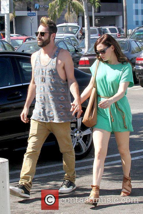 Rose McGowan out and about with her boyfriend...
