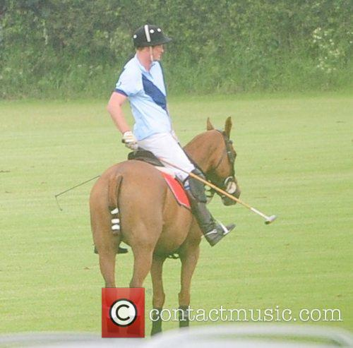 Prince Harry is seen playing a polo match...