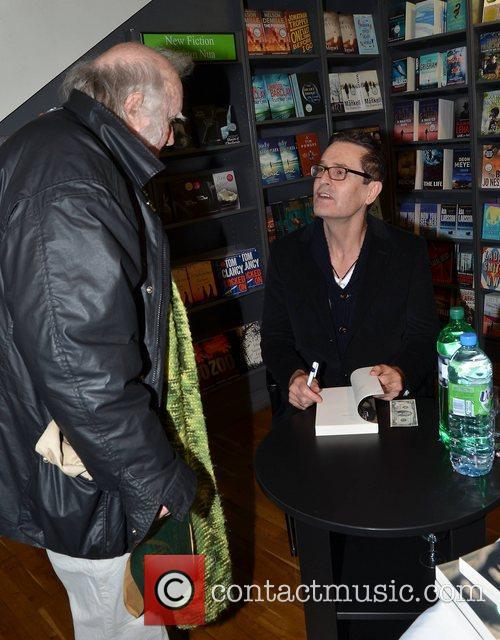 Rupert Everett signs copies of his book entitled...