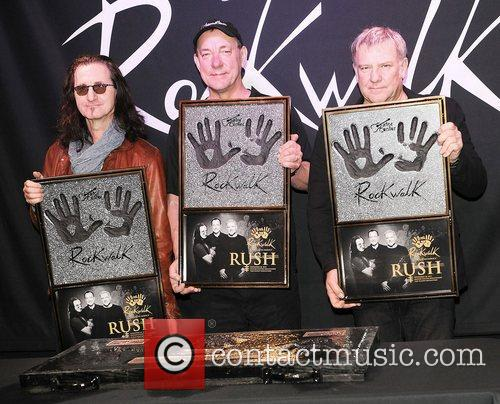 Are honored on Guitar Center's RockWalk at Guitar...