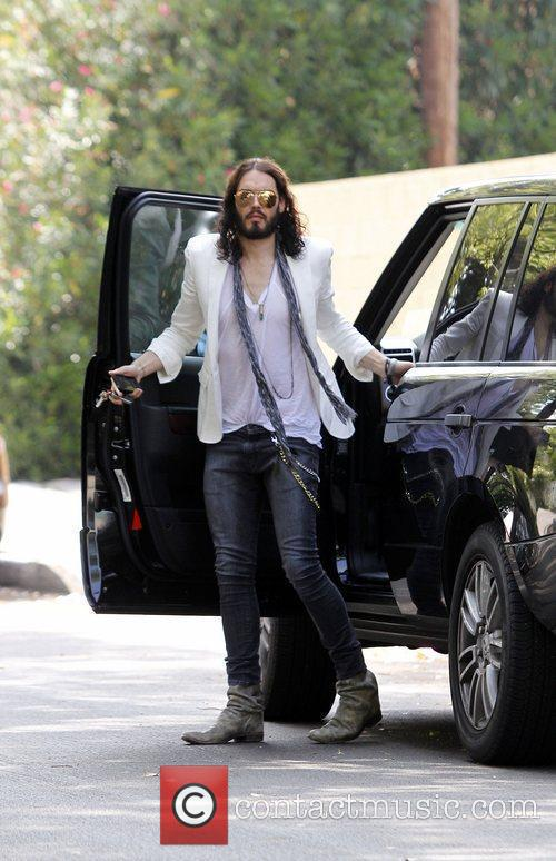 Russell Brand arrives at a photographic studio in...
