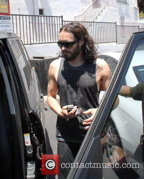 Russell Brand gets into his car in Sunset...