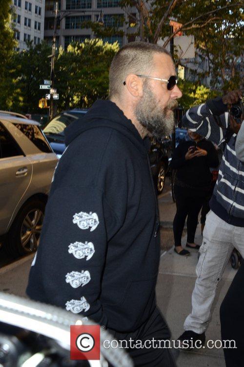 Russell Crowe is seen leaving his hotel in...