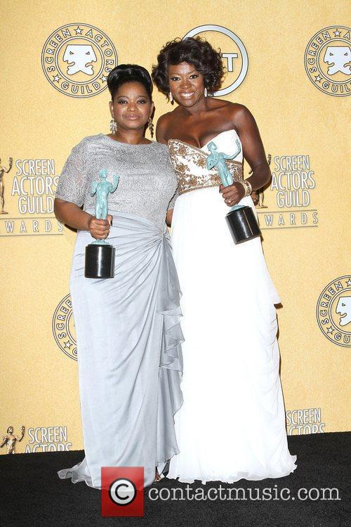 Octavia Spencer (L) and Viola Davis with their...