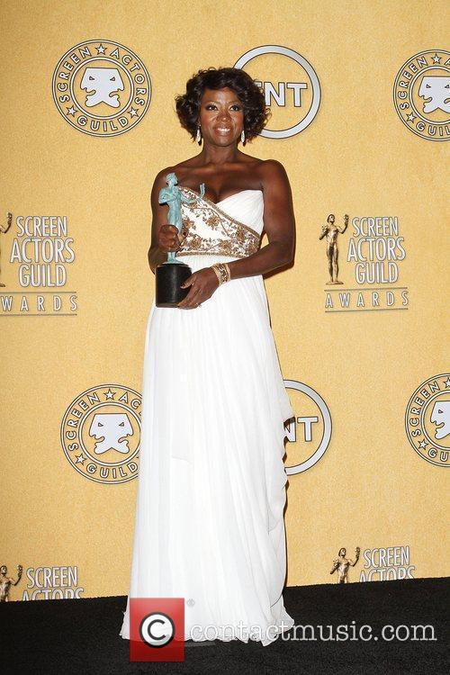 Viola Davis with her award for Outstanding Performance...