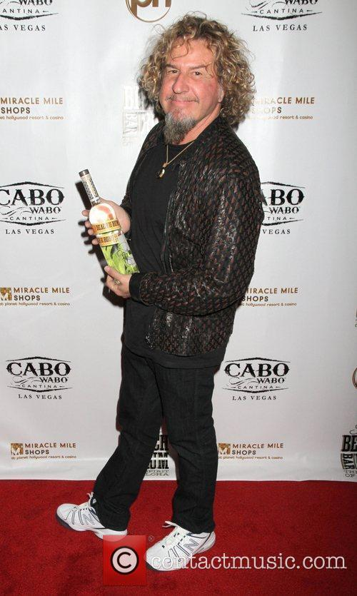 Launches his new drink 'Sammy's Beach Bar Rum'...