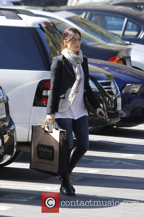 Sandra Bullock is seen taking her son to...